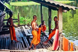 Buddhist-monks-talking-near-the-Tonle-Sap-lake