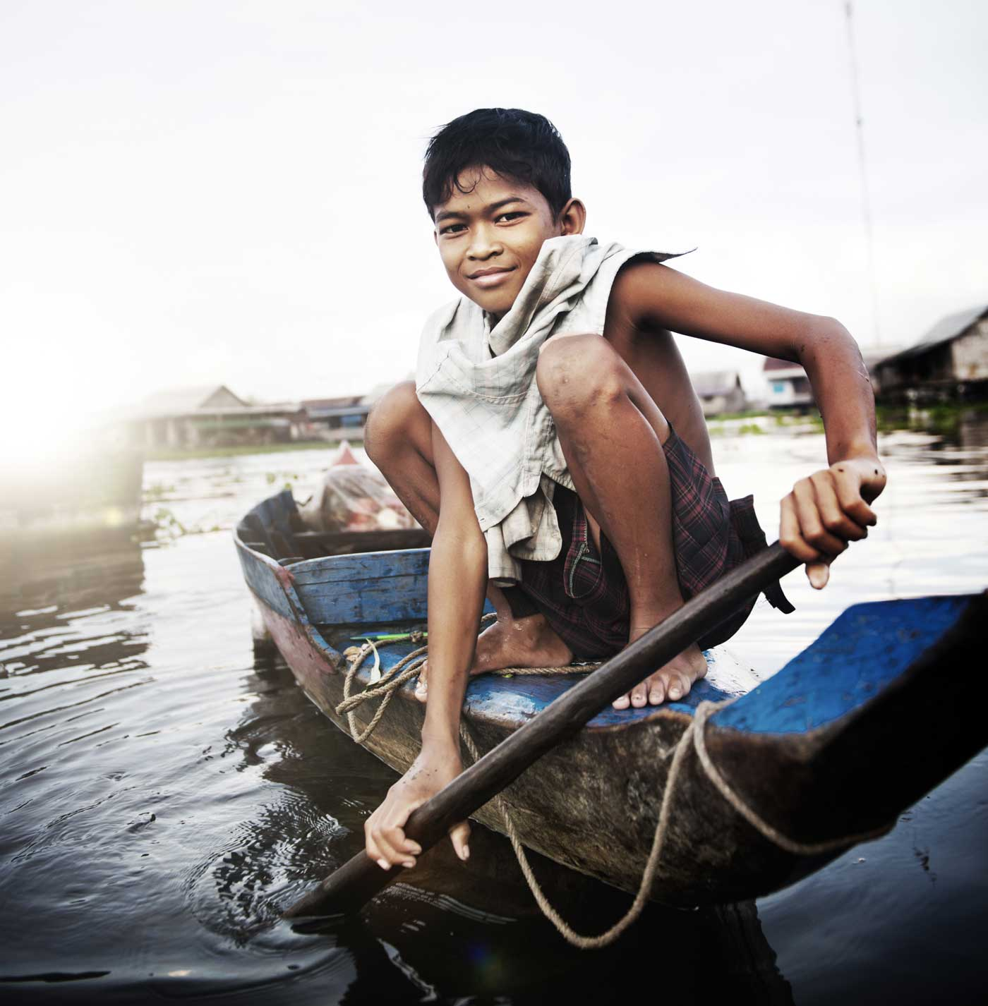 Green Cultural Travel - Cambodia - Siem Reap - Floating Village - Boy on a boat